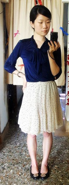 navy chiffon blouse with neck bow + white pleated skirts + black flats with gold medal + low ponytail.