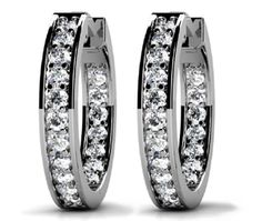 These classic diamond hoop earrings in 14k white gold feature 18 round cut diamonds in the inside and outside of each hoop in a prong setting. Approximately 3/4 carat total diamond weight, made by http://brilliance.com