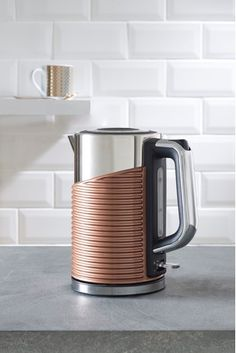 Make life simpler with electrical appliances that also add style to your home. Shop kitchen and home appliances. Electrical Appliances, Kitchen Appliances, Kettle And Toaster Set, Cord Storage, Kitchen Tops, Kitchen Ideas, Heating Element, Coffee Maker, Chrome