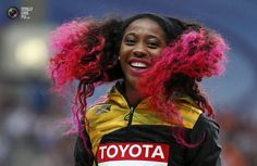 COOLEST SPORTS PIX OF 2013 WEEK 33 - Gold medallist Fraser-Pryce of Jamaica smiles at the women's 100 metres victory ceremony during the IAAF World Athletics Championships at the Luzhniki stadium in Moscow. GRIGORY DUKOR/REUTERS