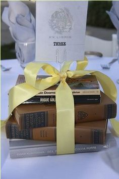 Book centerpiece idea. I would replace the ribbon with twine.