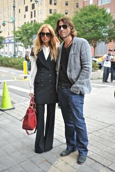 Rachel Zoe and Rodger Berman at New York Fashion Week - We love her vest dress... and yes, we have it at Skirt! She's paired it with a long silk blouse and tailored trouser underneath