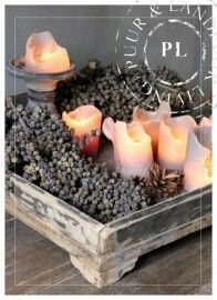 wooden tray with pine cones and candles
