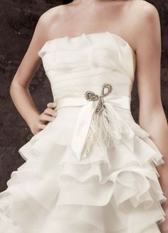 """White by Vera Wang clip adds a touch of glamour to any bridal look.  Vintage-inspired clip features crystal bow and feather spray.  Entire piece measures 7.5"""". Bow measures 4x 3.75"""".  Imported."""