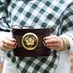 Fun fall Thanksgiving essentials: a cozy plaid wrap, a festive clutch and a York Design Co needlepoint cuff. You'll be best dressed at the dinner table!