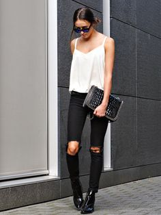Black distressed denim + white cami.