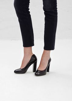 """High heel in a black, smooth leather with round toe, 4.25"""" heel with rubber plate and black leather sole. Dust bag included."""