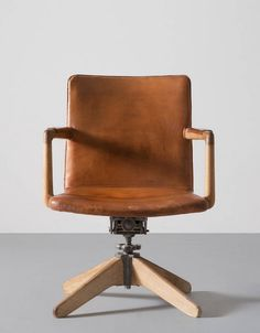 Hans Wegner; #421 Oak, Iron and Leather Adjustable Armchair for Plan Møbler, 1940.