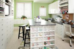 Love the lower counter on one wall and the tall set of drawers on the opposite with an island in the middle