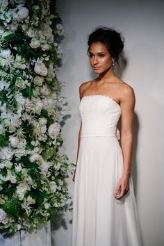 The First Time - Stewart Parvin. Photography by www.davidburkephotography.co.uk  A utterly feminine strapless gown with flowing soft circular, silk georgette skirt coupled with Ashley lace finished with two corsage roses at the back waist. #weddingdress #strapless #georgette #lace #soft #corsage