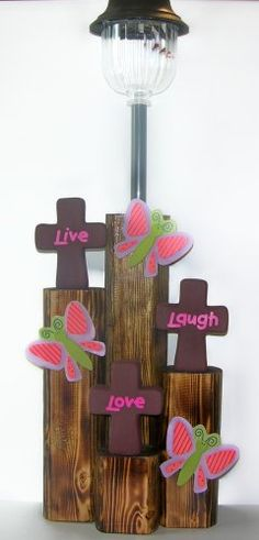 3 Crosses with love, live, laugh, handpainted ceramic with painted wood butterflies. The base is a finished landscape timber with a solar light. Landscape Timber Crafts, Landscape Timbers, Landscape Design, Solar Lamp, Solar Lights, Lawn Lights, Wrapping Ideas, Wooden Crafts, Diy And Crafts