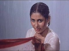 Frolicking aplenty in this wet sari number from the Eighties superhit Namak Halaal (Prakash Mehra, This song stars Amitabh Bachchan the greatest superstar of Bollywood film.