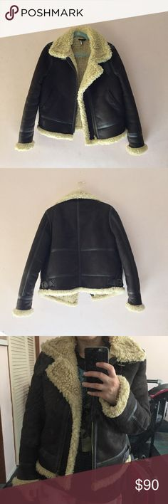 Topshop Shearling Jacket Super warm and comfortable, faux suede exterior and faux shearling interior, buckle detail at neck, gently worn, dry clean only. First photo is not actual jacket but similar style. Topshop Jackets & Coats