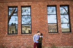 Kiss in front of a brick building // Cameron Ingalls photography