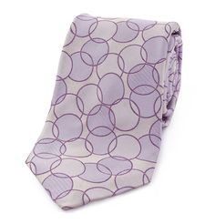MOSCHINO - GEOMETRIC PRINT SILK TIE  This geometric print tie is easy on the eyes because of the soft colour which complements any light shade of shirt and formal trousers. This Moschino necktie is made of 100% silk.