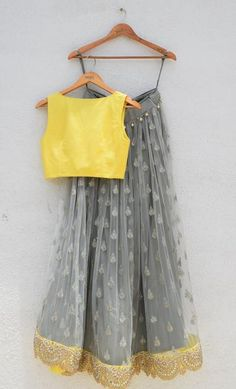 Grey Silver Zardosi Embroidered Lehenga With Yellow Blouse And Yellow Dupatta Grey Yellow Zardosi Sequence Designer Lehenga Set teamed with a pearl border dupatta. Hot favourite for Engagement, Mehendi,Sangeet. Our Hot Bestseller Half Saree Designs, Lehenga Designs, Saree Blouse Designs, Indian Wedding Outfits, Indian Outfits, Wedding Attire, Indian Clothes, Wedding Dresses, Lehnga Dress