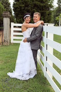 Bride and groom with fence Heidi Burks Photography