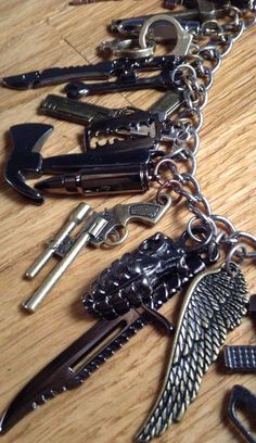 The Walking Dead Charm Bracelet. I don't even want this because it's walking dead, I want this because it's freaking awesome (: