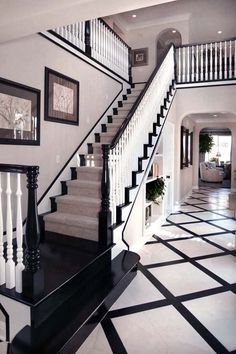 A staircase guides visitors upstairs immediately upon entering the house. Entryway Staircase : Design Line Interiors : Entryways And Halls : Pro Galleries : HGTV Remodels Contemporary Hallway, White Stairs, Black Staircase, Black Banister, Staircase Design, Painted Staircases, Painted Stairs, Foyer Decorating, Decorating Ideas