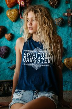 - You'll want to live in our new logo crop tank featuring a crew neck, cut-off sleeves and Moroccan-inspired 'Spiritual Gangster' graphic. - Made from a super soft tri-blend jersey. Polyester / Cotton