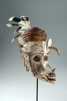 Dayak Hudoq Mask, early 1900s, Kayan peoples, Kalimantan, Indonesia. Carved and painted wood with feathers and grass.