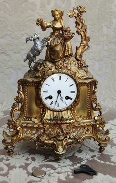 Antique French Ormolu Bronze Mantel Clock. My grandmother had one representing Little Red Riding Hood