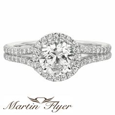 This Martin Flyer #Diamond #EngagementRing is halo style with a #rounddiamond along with 62 other diamonds!