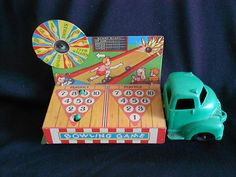 Antique Vintage - Tin Litho Toy Truck Banner Bowling Game Spin The Wheel