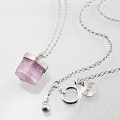 0129  A simple, minimalist silver necklece with beautiful, pink tourmaline. The stone is framed in satinated silver and the chain and clasp are polished. Entirely hand made.  $114.64 Click to see details!
