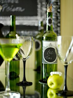 Fill empty, clean wine bottles with your own mixed concoctions and use a white gel pen to add spooky names to DIY labels.
