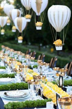 """Hot air balloon """"centerpieces"""" hanging over reception table. #reception #weddingdecor #weddingballoons"""