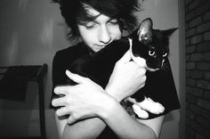 Hot guy with cat.