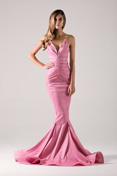 Symmetrically pleated strapless mermaid gown.-Michael Costello US Size Chart-Terms / Conditions-Shipping- Made to order- Include inches of heels when selecting height- Dry clean only- Emailinfo@shopcostello.comto inquire about different color options- Thinking about custom measurements? Ask us about custom optionscustom@shopcostello.com