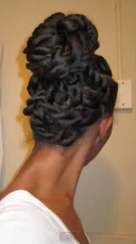 Hair blown out and flat twisted into a bun.  Beautiful protective style