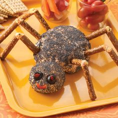 Spider Cheese Ball Recipe ~ This southwestern-flavored cheese ball is shaped into a black spider to spook all your guests at your next Halloween gathering!