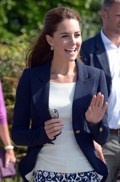 The Duchess gives onlookers a cheerful wave - 02/09/2016