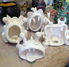 Ready for glaze... Pinch pot monsters!