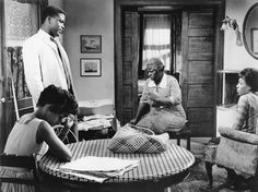 Ruby Dee, Sidney Poitier, Claudia McNeil, and Diana Sands, who played the character of Beneatha Younger, in a scene from 'A Raisin in  The Sun'