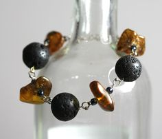 Bracelet of natural Baltic Amber and lava on sterling silver by HeymesBalticAmber