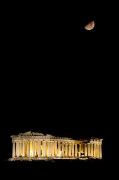 Gorgeous night shot featuring the Parthenon illuminated from within & a deep black starless night with a half moon. Always wanted to visit these ruins in Athens, Greece.