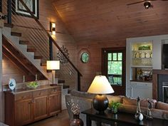 This striking log home in the mountains was given a complete modern renovation by StudioTrimble, located in Blue Ridge, Georgia. Contemporary Decorative Pillows, Contemporary Interior, Glass Stairs, Steel Stairs, Log Cabin Homes, Colorful Interiors, Decor Styles, Log Log, Blue Ridge