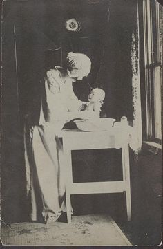 I found this incredible original vintage photo in a group of ephemera I bought today. How marvelous is it. The mother's and babies look, the mother's outfit and cap, the beautiful light coming in from the window. Perfect.