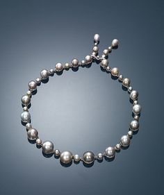 A STRAND OF NATURAL PEARL AND DIAMOND NECKLACE