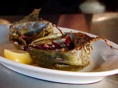 Fire-Grilled Artichokes recipe from Diners, Drive-Ins and Dives via Food Network