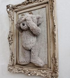 Put old stuffed animal in a frame.