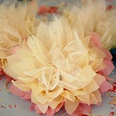 Gift Wrapping with Flowers - Tip Junkie  Tulle layered with color. Actual how do in this blog (several clicks in)