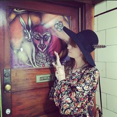 Touching Vali Myers studio door with new 'V' for Vali tattoo by fellow child of Vali @m_i_s_o_  xx