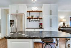 Kitchen with black soapstone counter island and white cabinetry subway tile backsplash Classic White Kitchen, Kitchen Design Small, Replacing Kitchen Countertops, Farmhouse Style Kitchen Cabinets, White Backsplash, Black Kitchen Countertops, Kitchen Design Plans, Black Countertops, Contrasting Kitchen Island
