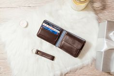 Convenient male wallet made from genuine calf leather in black.
