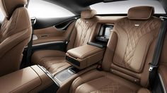 2015-S-CLASS-COUPE. Interior rear. Now I think that is a speaker in the middle console. Part of the Burmester 3D super sound system. I do like the seat stitching...